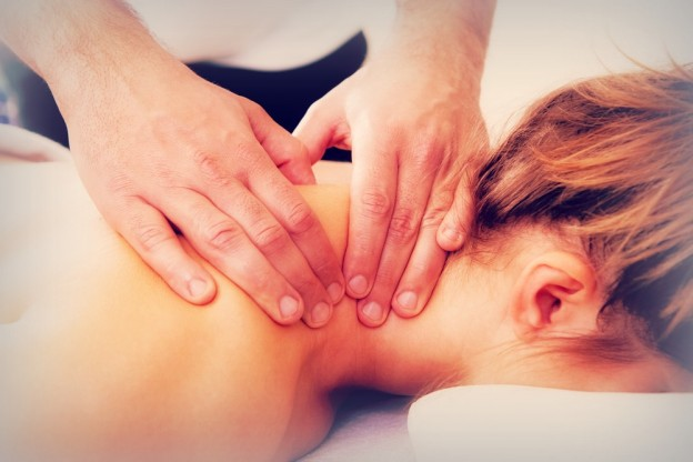Woman receiving therapuetic neck massage