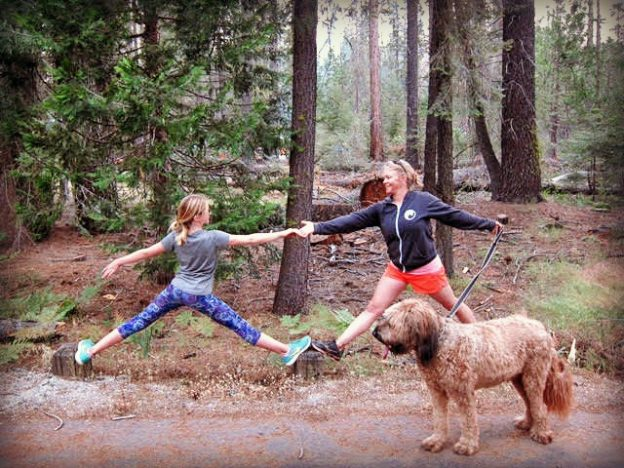 Dr. Kirsten Sage and daughter balancing on log in the Sequoia's